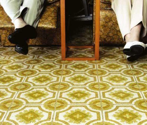 Underneath carpet or vinyl flooring